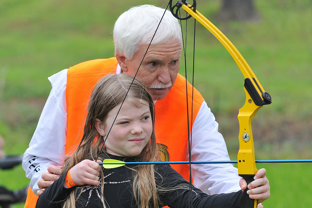 A child shooting a bow
